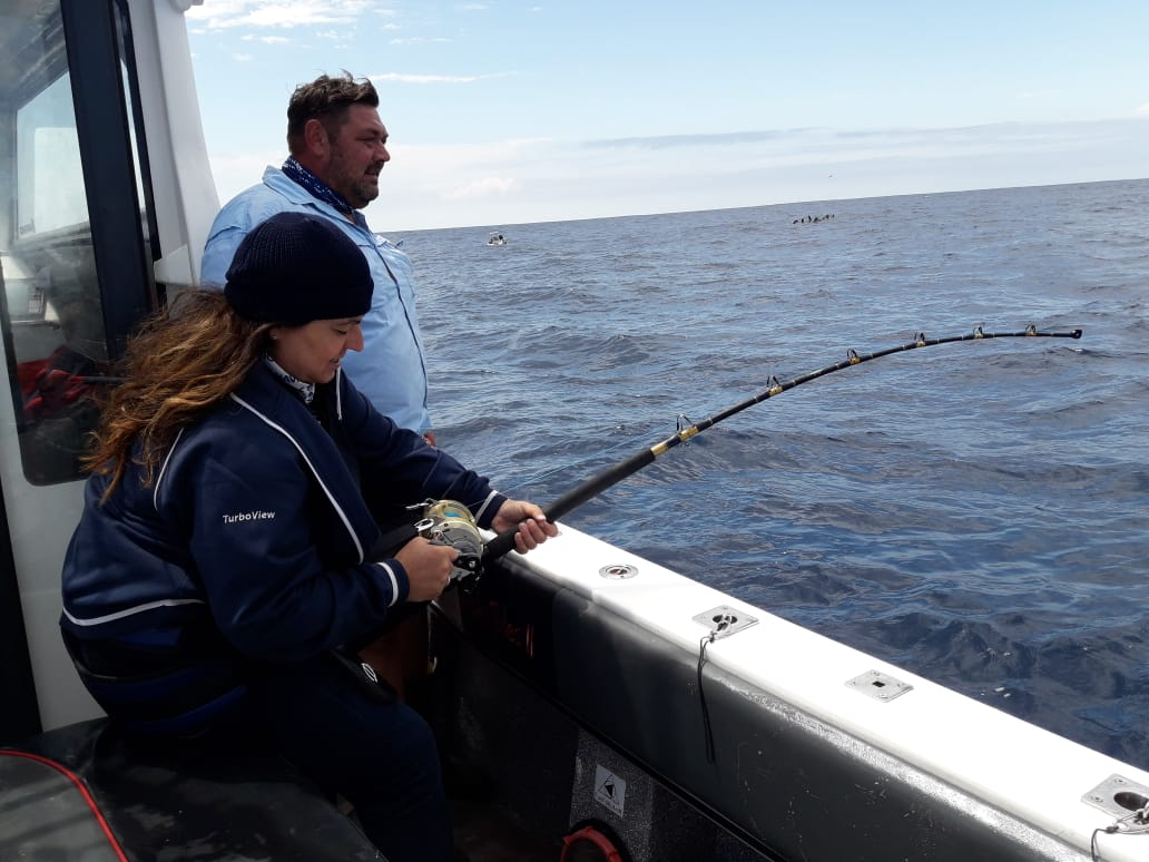 Woman catching Yellowfin